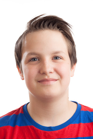 Closeup portrait of a teenage (13 years old) Caucasian boy, isolated on white background.