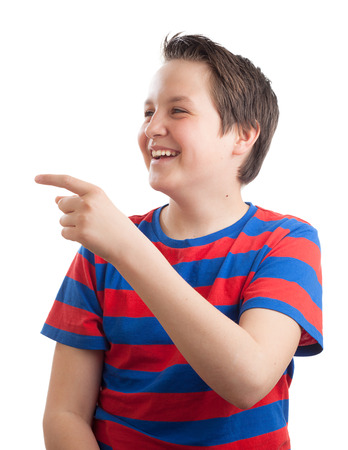 teenaged boy: Waist up portrait of a teenaged (13 years old) Caucasian boy, pointing and looking sideways, isolated on white background.