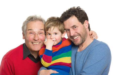 Three Caucasian male men of different generations: Grandpa, father and son. Studio shot isolated on white background. Stock Photo