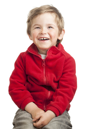 Portrait of a laughing toddler (2 years old) with blond hair in red jacket, isolated on white background. photo