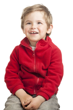 Portrait of a toddler (2 years old) with blond hair, curious look. Isolated on white background. photo