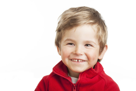 Portrait of a laughing toddler (2 years old) with blond hair, isolated on white background. photo