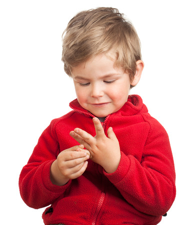 Portrait of a toddler (2 years old) with blond hair, counting with his fingers.Isolated on white background. photo
