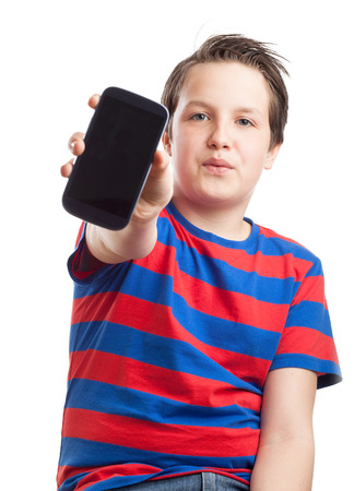 Teenage boy holding his mobile or smart phone into the camera photo