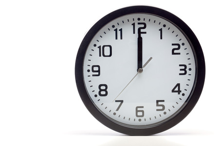 12 oclock: Analog clock with black frame, showing time of 12 oclock sharp, noon or midnight.  Cutout, studio shot, isolated on white background.