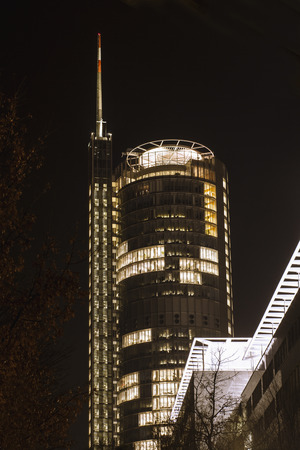 helipad: Office Tower with Antenna and Helipad at night. Essen, NRW, Germany. Stock Photo