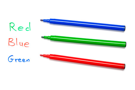 brain teaser: Red, blue, green pen with name of colors written mixed up as brain teaser, riddle. Cutout, isolated on white . Stock Photo