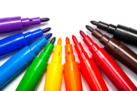 violett: Pens in colors like a rainbow, violett to red, brown and black. Cutout, isolated on white . Stock Photo