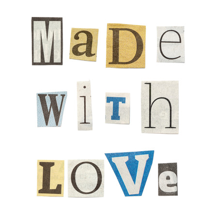 Made with Love - words composed from isolated, cutout newspaper letters. Stock Photo