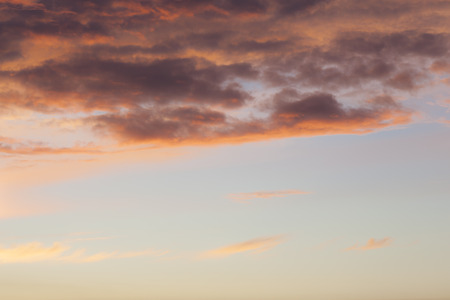 dramatically: Dramatically lit cloudscape in the sky, sunset coloring.