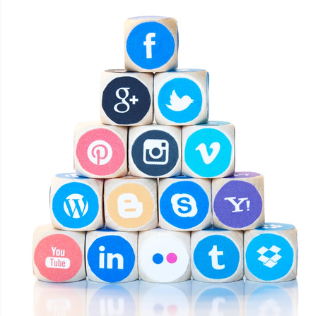 linkedin: Stack of dices in pyramid form with different social media network icons, logos, from Facebook through Google Plus, Twitter and Instagram to LinkedIn. Modern internet marketing concept.
