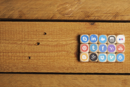 Concept - cubes of internet icons as game. Set of dices with logos from most popular social media networks, including Facebook, Google, Instagram, Twitter, Pinterest, LinkedIn and many more Editorial