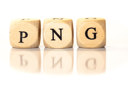 png: Term PNG spelled from toy cubes, dice letters with reflection on bottom. Studio shot on White background. Stock Photo