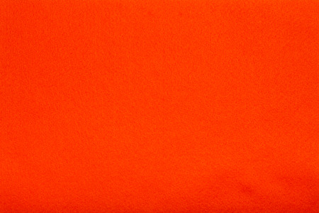 cloth background: Macro shot of orange felt tissue cloth, closeup texture background with details in structure.