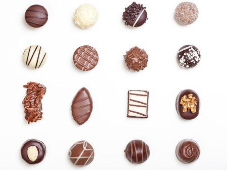 Variety of chocolate truffles, pralines, isolated on white background.