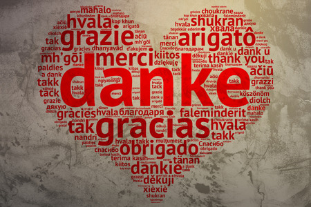 metadata: focus on German: Danke. Word cloud in heart shape on Grunge Background. saying thanks in multiple languages. Stock Photo