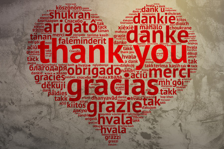 focus on English: Thank you. Word cloud in heart shape on Grunge Background. saying thanks in multiple languages. photo