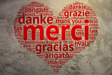 metadata: Focus on French: Merci. Word cloud in heart shape on Grunge Background. saying thanks in multiple languages.
