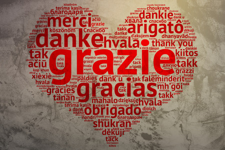 metadata: Focus on Italian: Grazie. Word cloud in heart shape on Grunge Background. saying thanks in multiple languages.