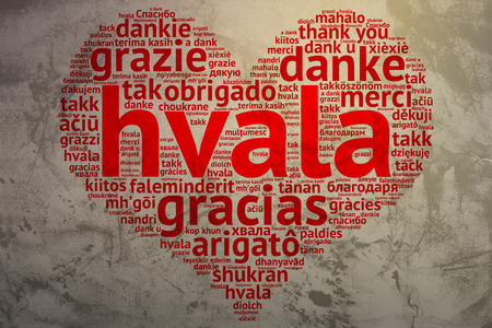 metadata: Focus on Serbian, Croatian: Hvala. Word cloud in heart shape on Grunge Background. saying thanks in multiple languages. Stock Photo