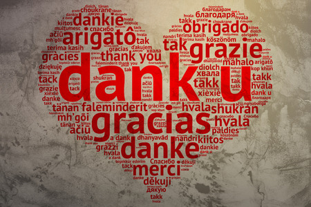 metadata: Focus on Dutch: Dank u. Word cloud in heart shape on Grunge Background. saying thanks in multiple languages. Stock Photo