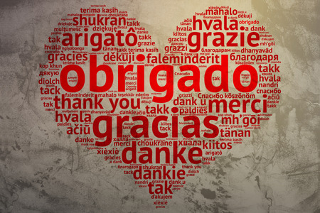 metadata: Focus on Portuguese: Obrigado. Word cloud in heart shape on Grunge Background. saying thanks in multiple languages.