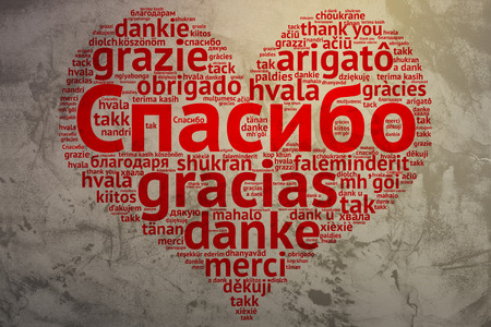 Focus on Russian: Spasiba, Word cloud in heart shape on Grunge Background. saying thanks in multiple languages. photo