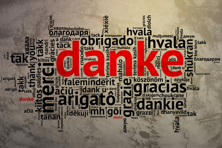 Focus on German: Danke. Word cloud in open form on Grunge Background. saying thanks in multiple languages. photo