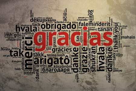 Focus on Spanish - Gracias, Word cloud in open form on Grunge Background. saying thanks in multiple languages.