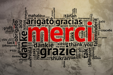 metadata: Focus on French - Merci. Word cloud in open form on Grunge Background. saying thanks in multiple languages. Stock Photo