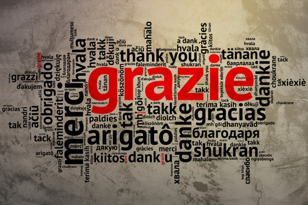 metadata: Focus on Italian - Grazie. Word cloud in open form on Grunge Background. saying thanks in multiple languages.