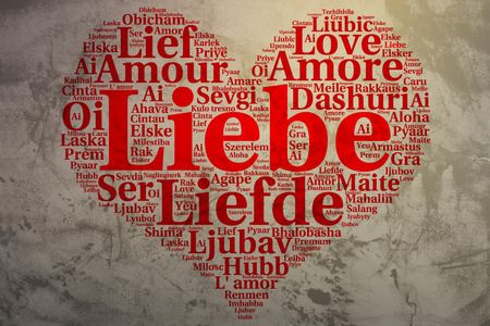 metadata: Focus on German: Liebe. Word cloud in heart shape on Grunge Background. saying thanks in multiple languages. Stock Photo