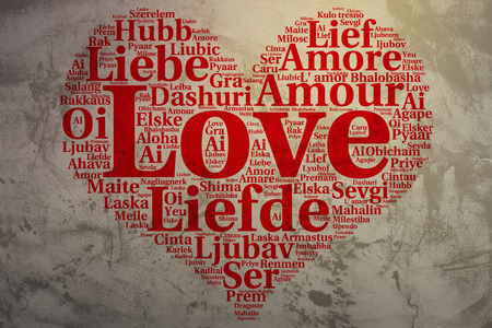 metadata: Focus on English: Love. Word cloud in heart shape on Grunge Background. saying thanks in multiple languages.