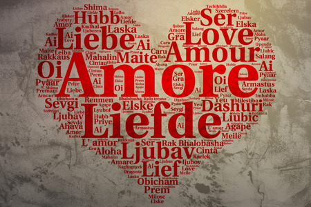 amore: Focus on Italian: Amore. Word cloud in heart shape on Grunge Background. saying thanks in multiple languages.