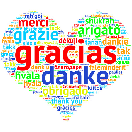 metadata: Focus on Spanish: Gracias. Word cloud in heart shape on white Background. saying thanks in multiple languages.