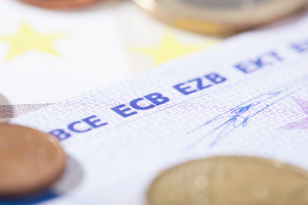 ecb: Closeup on bank notes. Shallow depth of field with focus in the center of the ECB characters.