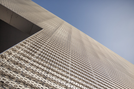 milled: Modern steel milled facade parts, closeup to architectural detail, metal works. Stock Photo
