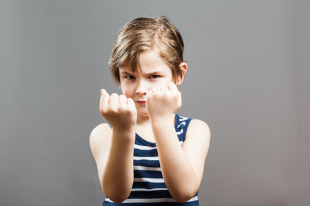 cool kids: Little Sportive Tough Boy in striped  muscle shirt, Picking a fight Stock Photo