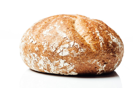 side shot: Side shot closeup on wholemeal or wholegrain bread roll, isolated on white background.