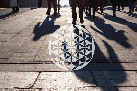 shamanism: Energetic chakra symbol from yoga on urban city life background