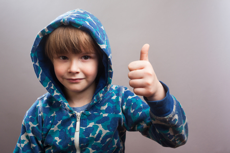 hoody: Happy Little Boy with blue Hoody Thumbs Up with his hand