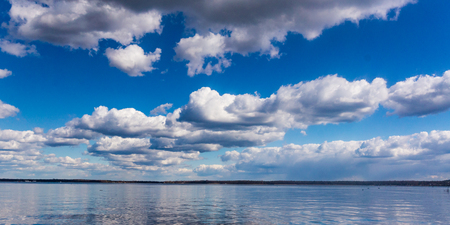 cloudscapes: Panoramic image of lake and cloudscapes on blue sky
