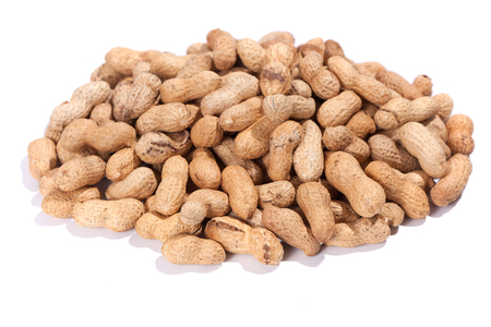 titbits: Heap of peanuts, isolated on white background