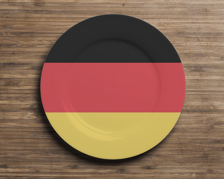 Plate on table with overlay flag of Germany