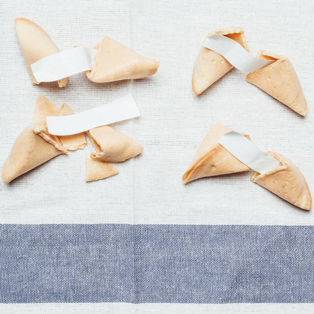 foretelling: Four fortune cookies on table cloth Stock Photo