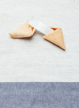 foretelling: Fortune cookie on white and blue table cloth