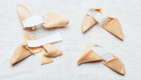 Four fortune cookies on table cloth Stock Photo