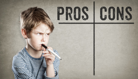 Boy listing pros and cons on grunge background, writing and thinking, copy space