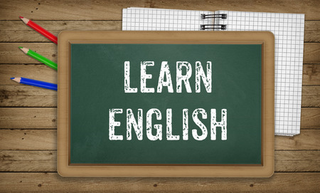 Learn English language, written in chalk on green board, education concept for school courses
