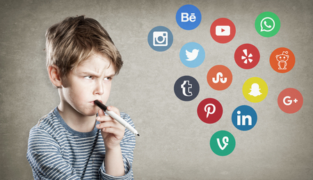 Boy with social media logos, writing and thinking about choice of networking